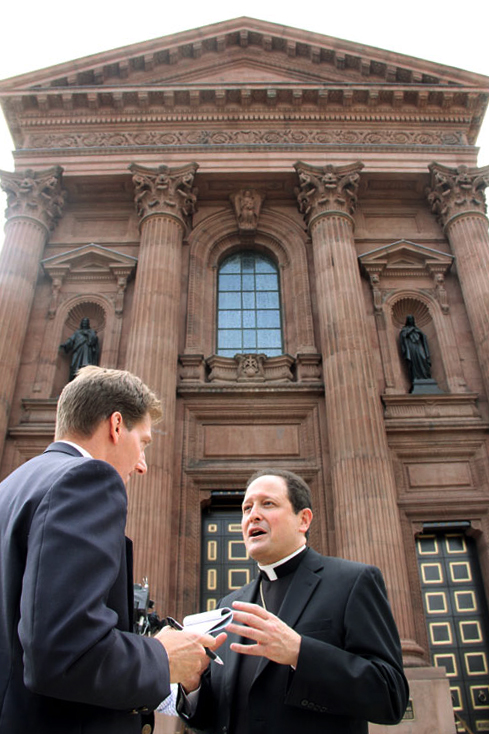 At the Cathedral Basilica of SS. Peter and Paul, Bishop John McIntyre describes to a reporter on June 30 the Mass Pope Francis will celebrate for the people of the Archdiocese of Philadelphia on Saturday, Sept. 26 at the start of his two-day visit to the city. (Sarah Webb)