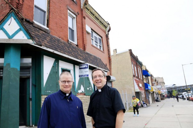 Fathers Joseph Devlin (left) and William Murphy stand in front of Mother of Mercy house, a new outreach to the poor residents of Kensington. (Photo by Sarah Webb)