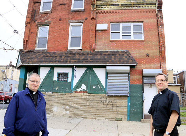 It might not look like much now, but Father Joseph Devlin (left) and Father William Murphy are proud of starting Mother of Mercy House to serve the poor in their Kensington neighborhood. (Sarah Webb)