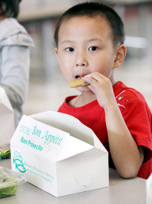 Kevin Lin is happy to have a cookie for dessert.