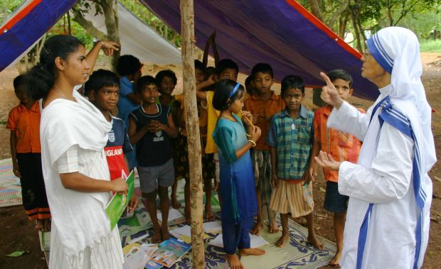 In this 2008 file photo, Missionaries of Charity Sister Nirmala Joshi meets Christian refugees who had been sheltered in Kandhamal, India.  (CNS photo/Anto Akkara)