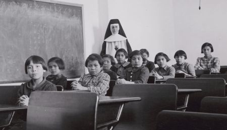 In this 1940 photo, a group of female students and a nun pose in a classroom at Cross Lake Indian Residential School in Manitoba. The Truth and Reconciliation Commission ended a five-year mandate to create a public record of the tragedy of Indian residential schools. (CNS photo/Library and Archives Canada, Reuters) See CANADA-RECONCILE June 3, 2015. Editors: editorial use only.