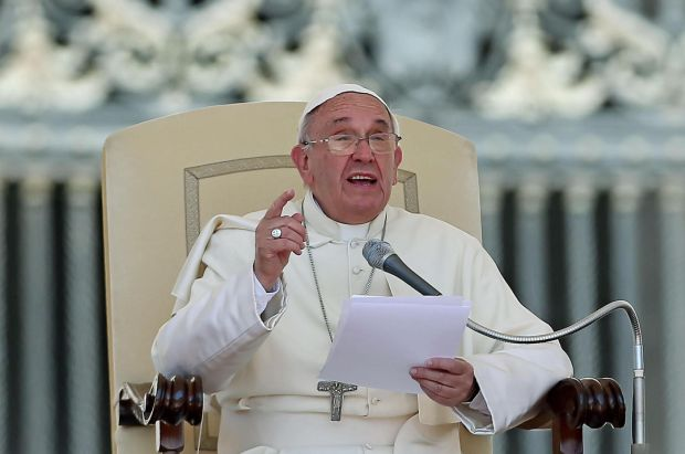 Pope Francis speaks during his weekly audience in St. Peter's Square at the Vatican. (CNS photo/Alessandro Di Meo, EPA)