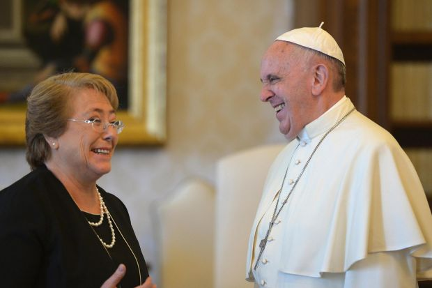 Pope Francis and Chilean President Michelle Bachelet laugh during a private audience at the Vatican June 5. (CNS photo/Alberto Pizzoli, pool via EPA)