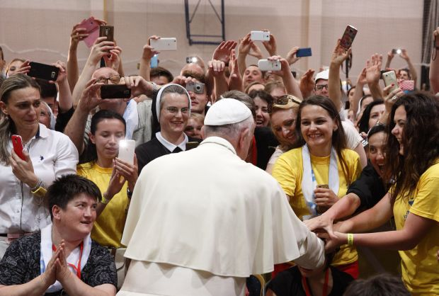 Pope Francis greets young people during a meeting with them at the diocesan John Paul II Youth Center in Sarajevo, Bosnia-Herzegovina, June 6. (CNS photo/Paul Haring)