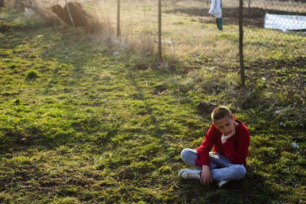 A Roma boy sits in the backyard of a house in Gyongyospata, Hungary, March 24. Pope Francis said focusing on poverty and sacrificing for the poor are the heart of the Gospel, not signs of communism. (CNS photo/Zoltan Balogh, EPA)