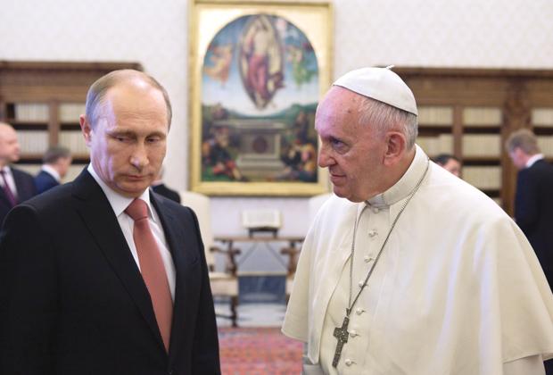 Pope Francis talks to Russian President Vladimir Putin during a private meeting at the Vatican June 10. (CNS photo/Maria Grazia Picciarella, pool)