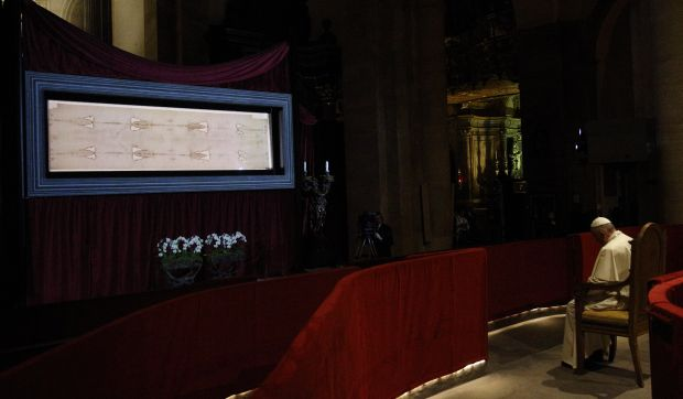 Pope Francis prays in front of the Shroud of Turin in the Cathedral of St. John the Baptist in Turin, Italy, June 21. (CNS photo/Paul Haring)