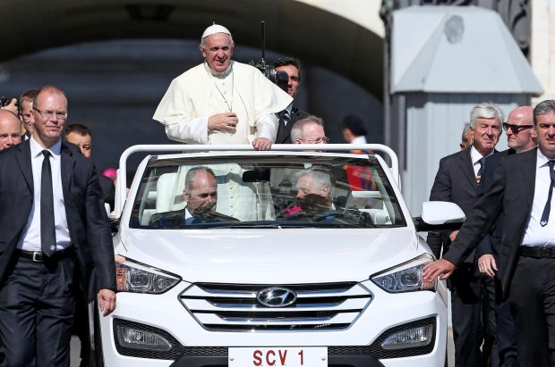 Pope Francis rides in his popemobile during his weekly audience in St. Peter's Square at the Vatican June 3. (CNS photo/Alessandro Di Meo, EPA)