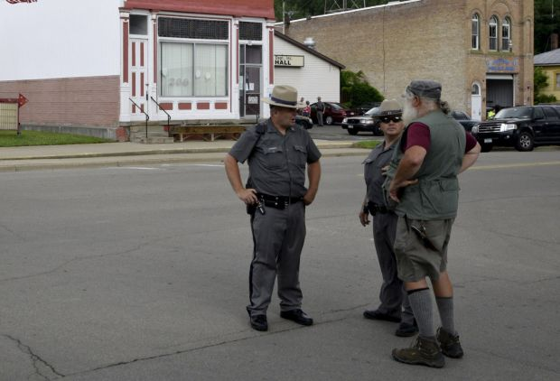 New York State Police are seen on a street in Friendship, New York, June 21. Law enforcement officials are engaged in a manhunt for convicted murderers Richard Matt and David Sweat, who escaped June 6 from a maximum security prison in Dannemora, N.Y. (CNS photo/Aaron Harris, Reuters)