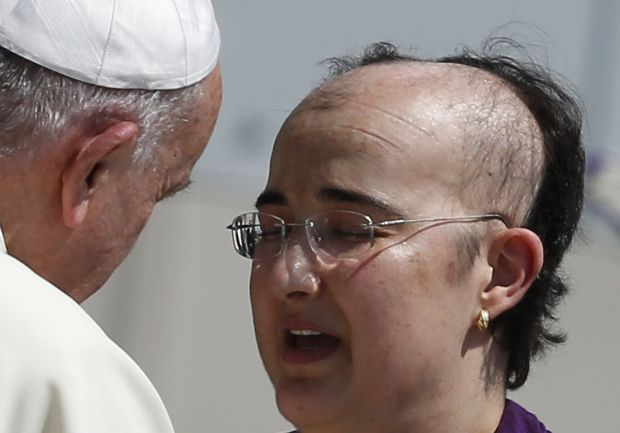 Pope Francis greets a woman as he meets the disabled during his general audience in St. Peter's Square at the Vatican June 10. In his audience talk, the pope spoke about the care of the sick within families. (CNS photo/Paul Haring)