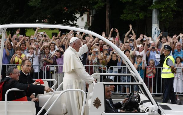 Pope Francis greets the crowd lining the road as he arrives for a meeting with young people at the diocesan John Paul II Youth Center in Sarajevo, Bosnia-Herzegovina, June 6. The pope made a one-day visit to Bosnia-Herzegovina to encourage the minority Catholic community in the faith and to foster dialogue and peace in a nation still largely divided along ethnic lines. (CNS photo/Paul Haring)