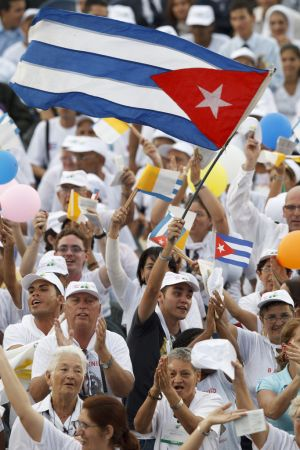 A young man waves Cuba's flag during the 2012 visit of Pope Benedict XVI to Cuba. Pope Francis will visit Cuba Sept. 19-22.(CNS photo/Paul Haring)