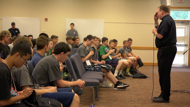 Father Stephen DeLacy leads the young men in prayer at the 2014 Quo Vadis retreat.