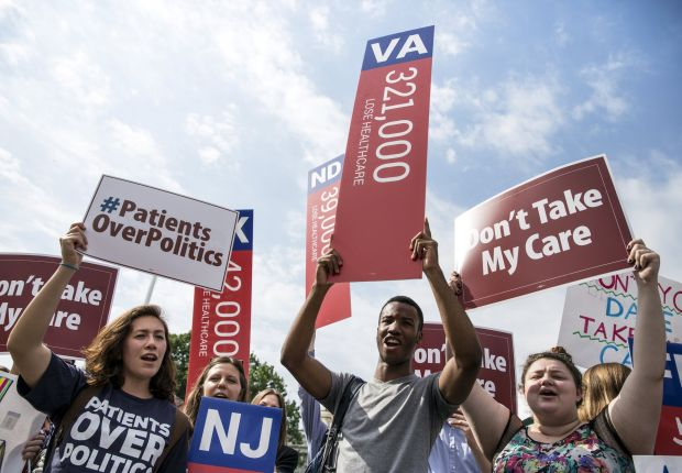 Supporters of the Affordable Care Act rally at the Supreme Court in Washington June 25. The justices in a 6-3 decision upheld tax subsidies for participants in health exchanges run by the federal government in states that refused to create them. (CNS photo/Joshua Roberts, Reuters)