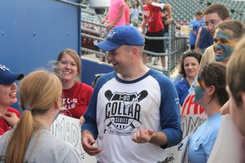 Father Paul Hoesing, outgoing vocation director for the Archdiocese of Omaha, Neb., talks with fans June 21 following the I-80 Collar Series softball game in Papillion, Neb. (CNS photo/Susan Szalewski, Catholic Voice)
