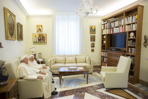 Pope Francis chats with retired Pope Benedict XVI during a meeting at the Vatican June 30. (CNS photo/L'Osservatore Romano via Reuters )