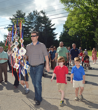 Families and other parishioners of St. Norbert Parish, Paoli, walk in the procession which was followed by Mass and a parish picnic Saturday, June 6.
