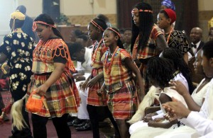 Youth dance up the asile as the gift are brought up