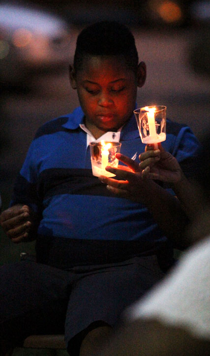 James McKinight prays for the nine who lost thier lives in the SC shooting