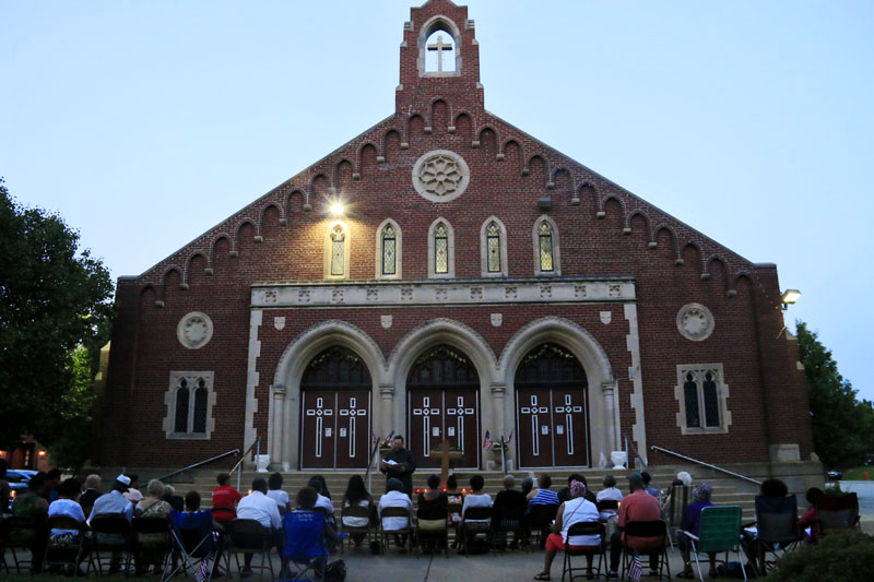 Fr Christopher Walsh leads the prayer services at dusk