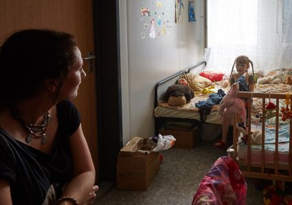 Tetiana Stawnycha, head of the Ukrainian Greek Catholic Church Development Office speaks with a girl from Horlivka, Ukraine, June 21 in a shelter for displaced Ukrainians. (CNS photo/Sergey Kozlov, EPA)
