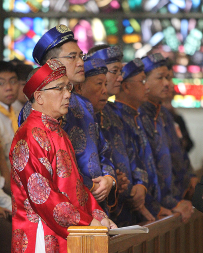Members of the Vietnamese Catholic community wear their traditional attire. (Sarah Webb)