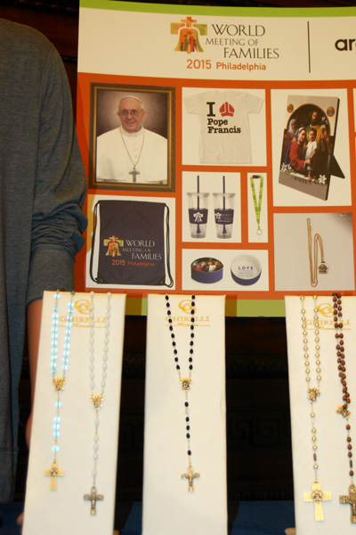 Rosary beads were just some of the religious articles emblazoned with the World Meeting of Families logo or Pope Francis' image on display June 1.