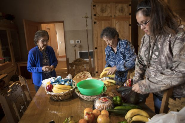 Food given during the offertory at St. Augustine Mission is organized by women to be distributed to the needy in the Pueblo of Isleta, N.M., in this November 2014 photo. Pope Francis' long-anticipated encyclical on the environment was released at the Vatican June 18. (CNS photo/Nancy Wiechec)