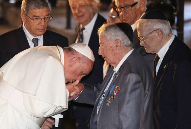 Pope Francis kisses the hand of a man during a ceremony in the Hall of Remembrance at the Yad Vashem Holocaust memorial in Jerusalem May 26, 2014. The pope honored the 6 million Jews who perished at the hands of the Nazis during the Holocaust. (CNS photo/Abir Sultan, EPA)