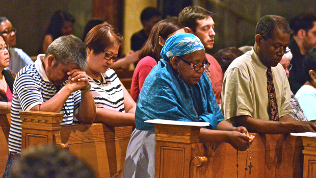 Faithful at the Basilica of the National Shrine of the Immaculate Conception in Washington pray the rosary in the shrine's Crypt Church June 12.  The national shrine was one of 84 shrines in 46 nations that participated in the 2015 Global Rosary for Priests. (CNS photo/Michael Hoyt, National Shrine of the Immaculate Conception)