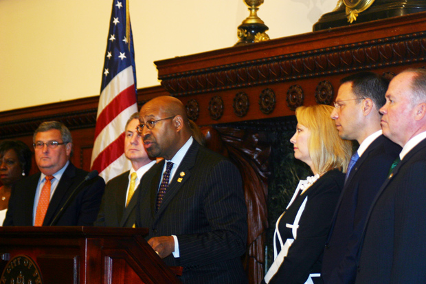 Philadelphia Mayor Michael Nutter describes initial transportation plans for the visit of Pope Francis Sept. 26-27, during a press conference in June with officials including Donna Crilley Farrell of the World Meeting of Families, at right. (File photo)
