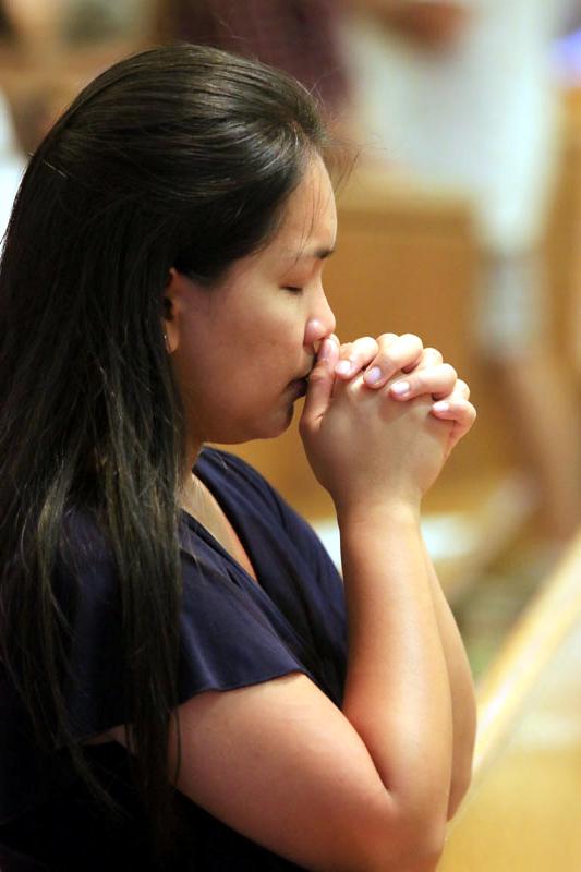 Valerie Malcolm from St Anne parish prays