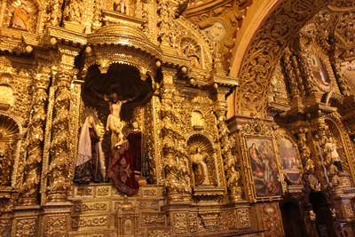 More than 100 pounds of gold leaf adorns the side altars of the Iglesia de la Compania in Quito, Ecuador's Jesuit church. (CNS/Barbara Fraser)