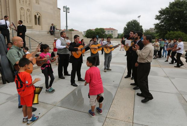 People sing and dance July 4 outside the Basilica of the National Shrine of the Immaculate Conception in Washington before attending a Mass on the final day of the U.S. bishops' Fortnight for Freedom campaign. (CNS photo/Bob Roller)