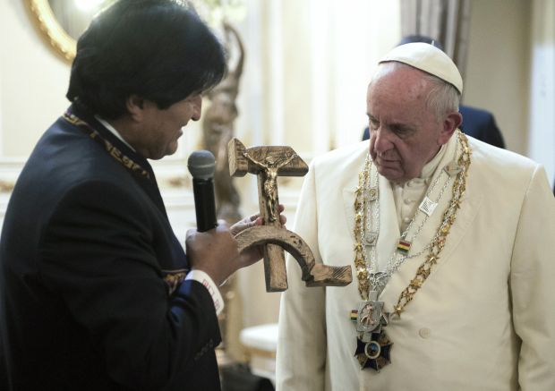 Bolivian President Evo Morales presents a gift to Pope Francis at the government palace in La Paz, Bolivia, July 8. The gift was a wooden hammer and sickle -- the symbol of communism -- with a figure of a crucified Christ. (CNS photo/L'Osservatore Romano)