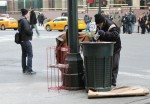 A homeless man searches a trash can for bottles and cans to redeem for money in New York City in 2014. Ahead of Pope Francis' apostolic visit to the United States in September, some are bracing themselves for more criticisms from the pope, this time directed specifically at the U.S. culture and economy. (CNS photo/Gregory A. Shemitz)