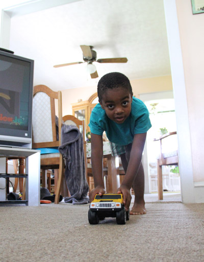 Jamil Paul plays with a toy truck like any boy in the safety of his Northeast Philadelphia home. (Sarah Webb)