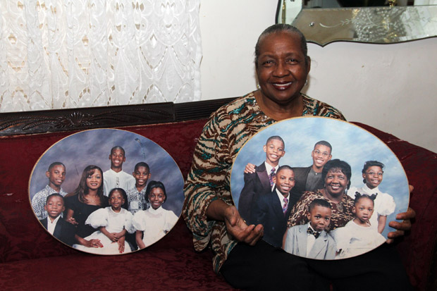 Sharonell Fulton displays pictures of some of the foster children she has cared for over the years. (Sarah Webb)