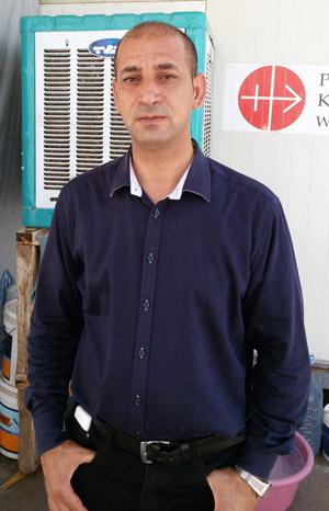 Father Bashar Kthea, 39, a Syriac Catholic priest, poses for a photo July 17 in Irbil, Iraq. (CNS photo/Sahar Mansour)