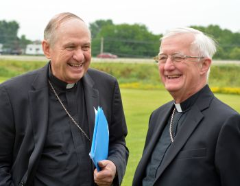 Bishop Richard E. Pates of Des Moines, Iowa, and Bishop Martin J. Amos of Davenport, Iowa, talk before a July 2 news conference on clean energy in Ankeny, Iowa. The bishops and other religious leaders urged Iowans keep Pope Francis' environmental encyclical in mind when talking to presidential candidates campaigning in the state. (CNS photo/courtesy Diocese of Des Moines)