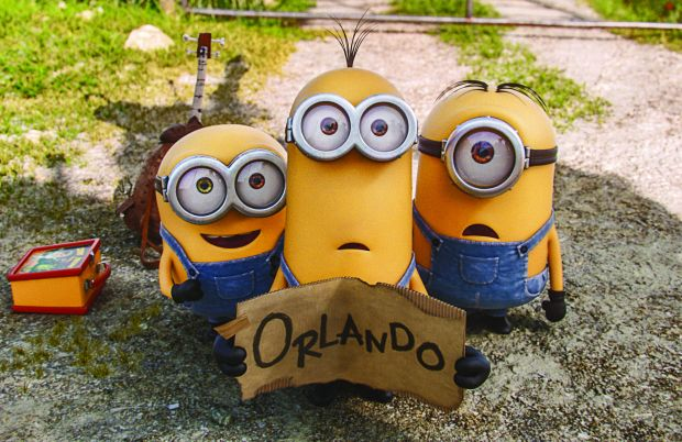 "Minions star in a scene from the movie ""Minions.""  (CNS photo/Image.net)"