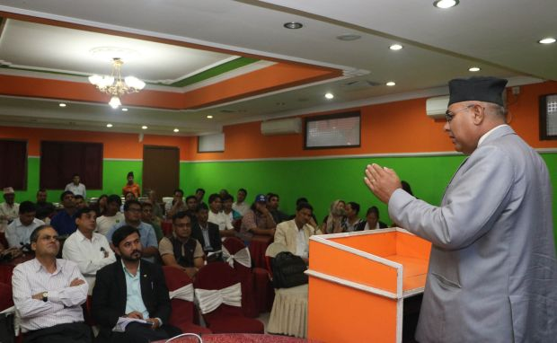 Lokmani Dhakal, one of the four Christians in Nepal's 601-member Constituent Assembly, briefs Christian leaders about the pitfalls in the new constitution at an ecumenical conference in Kathmandu July 6. (CNS photo/Anto Akkara)