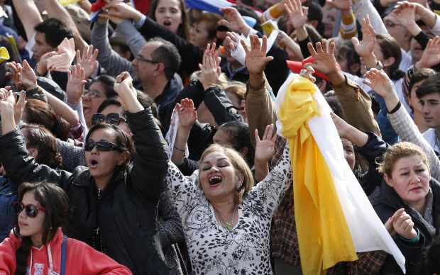 People cheer before Pope Francis celebrates Mass outside the Caacupe Marian Shrine in Asuncion, Paraguay, July 11. (CNS photo/Paul Haring)