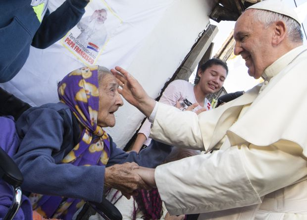 Pope Francis greets an elderly woman as he meets with people of Banado Norte, a poor neighborhood in Asuncion, Paraguay, July 12. (CNS photo/Paul Haring)