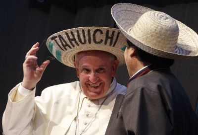 Pope Francis and Bolivian President Evo Morales try on traditional hats as they participate in the second World Meeting of Popular Movements in Santa Cruz, Bolivia, July 9. (CNS photo/Paul Haring)