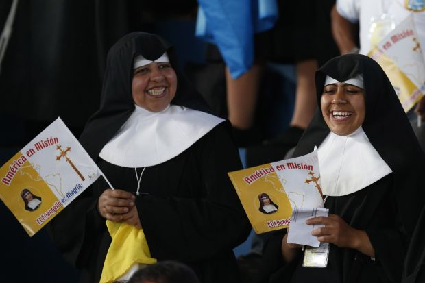 Nuns participate in entertainment before Pope Francis' arrival for a meeting with priests, religious men and women, and seminarians in the Don Bosco school in Santa Cruz, Bolivia, July 9. (CNS photo/Paul Haring)