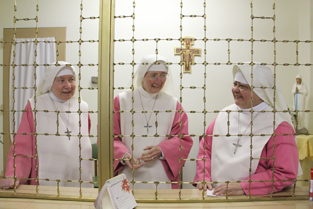 Three Pink sisters share a light moment at their Fairmount monastery. (Sarah Webb file photo)