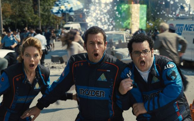 "Michelle Monaghan, Adam Sandler and Josh Gad star in a scene from the movie ""Pixels.""  (CNS photo/Sony)"