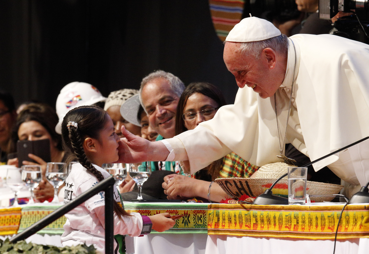 Pope Francis greets a young girl as he participates in the second World Meeting of Popular Movements in Santa Cruz, Bolivia, July 9. (CNS photo/Paul Haring)
